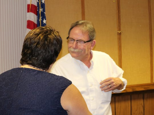 Peter Madden, newly appointed SASD board member, shakes