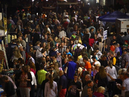 A crowd fills Henry Street in downtown Binghamton during