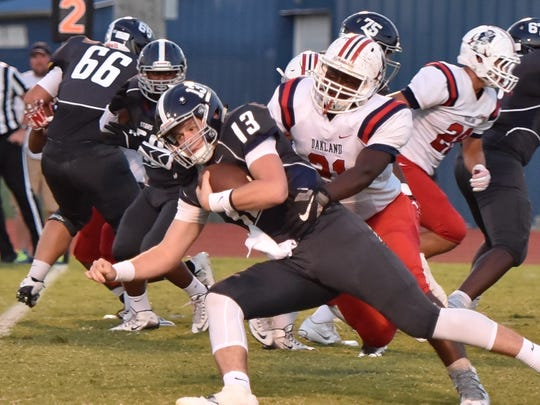 Siegel's Brendan Crowell tries to find running room during Friday's game against Oakland.