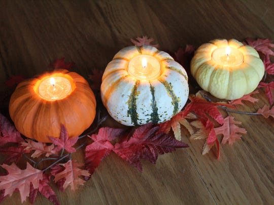 For a DIY touch, place tealight candles in hollowed-out gourds.
