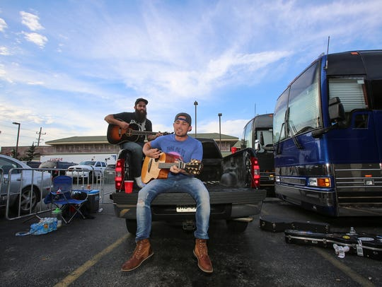 With a backup guitarist, country artist Michael Ray