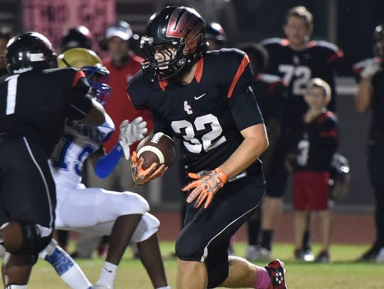 Stewarts Creek's Jackson Smith carries the ball against