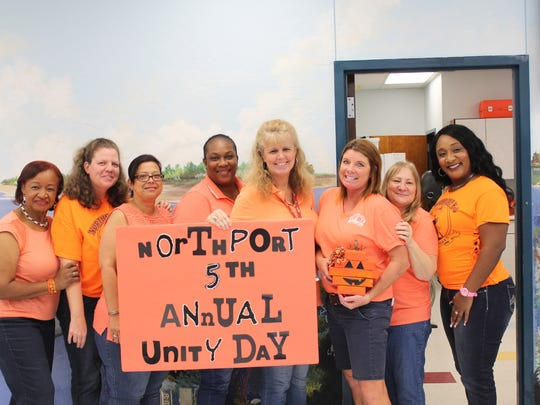 Northport Office and clerical staff help students celebrate Unity Day and the school's anti-bullying message.