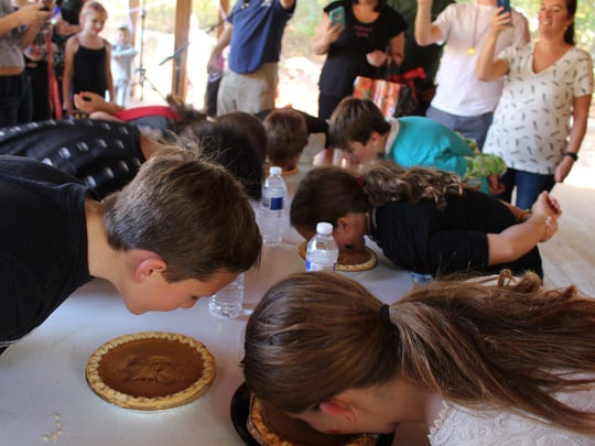Youngsters had two-minutes to dig into pumpkin pies without any hands during the Pumpkin Pie Eating Contest. Maya Zelinski, 11, was declared the winner.
