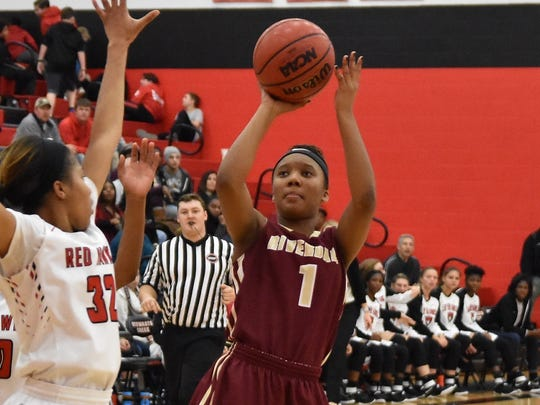Riverdale's Alasia Hayes shoots as Stewarts Creek's Brianah Ferby defends during a recent game. The Lady Warriors are No. 1 and Lady Red Hawks No. 5 in the latest AP polls.