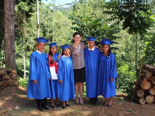 Kelly Waugaman stands with the first graduating class in Joconal, Guatemala, where her nonprofit organization began working in 2012.
