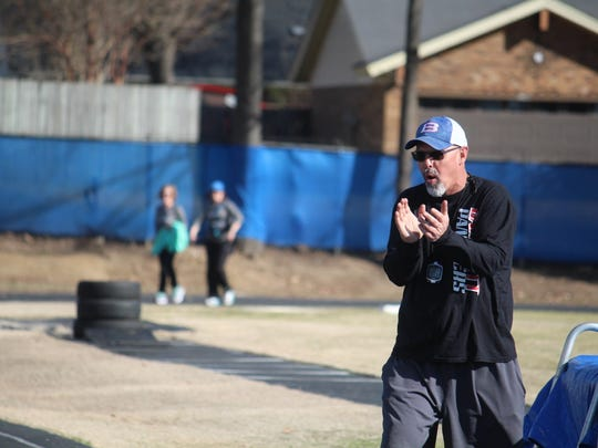 Bartlett High School track and field coach Don Myers encouraged the participants of the first Panther Prowl 5K on March 4. Proceeds from the race help cover expenses for the boys track and field team at the high school.