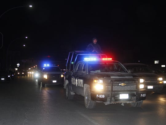 Juárez police during a crime-prevention operation in