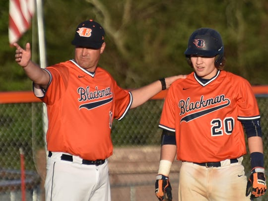 Blackman coach Justin Entrekin talks to senior Peyton Milam during a recent game against Riverdale. The Blaze are the top seeds in the 7-AAA tournament, starting Thursday.