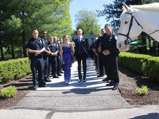 Police officers surprised Sierra Bradway for her prom.