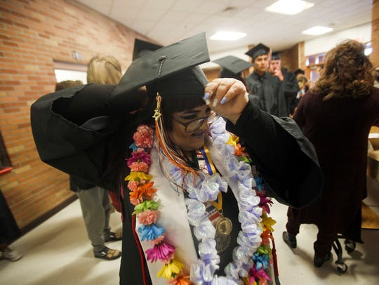 Irene Herren adjusts her cap Friday at Koogler Middle
