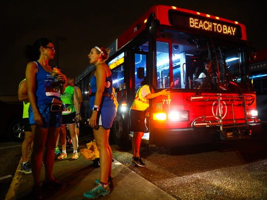 Runners get ready to board the Corpus Christi Regional Transportation Authority bus that will take them to their starting point along the 2017 Beach to Bay route.