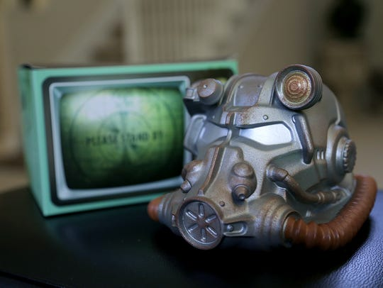 The Fallout 4 Power Suit Armor coin bank from the June