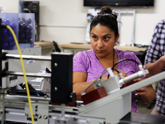 Cristina Tovalin works on a training machine at Truckee Meadows Community College's William N. Pennington Applied Technology Center on July 25, 2017. The machine is used to train students for Panasonic jobs at the Tesla Gigafactory.