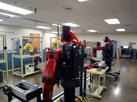 A row of robots inside Truckee Meadows Community College's William N. Pennington Applied Technology Center. The robots are used to train students interested in advanced manufacturing jobs, including those available at Tesla's Gigafactory.