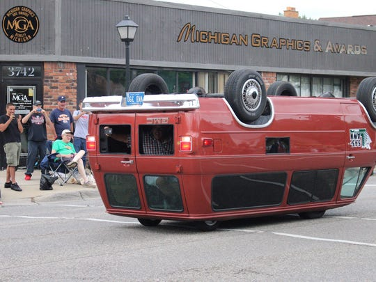 Don't worry, this wasn't the result of a Dream Cruise collision. The drivers of this customized van turned it on its head and drove it around Saturday.
