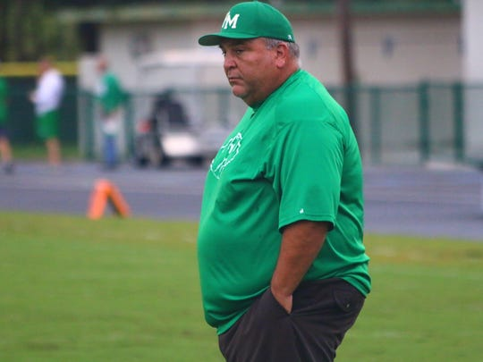 Fort Myers High football Coach Sam Sirianni Jr. watches over his players before the game against Clewiston on Saturday, Aug. 26, 2017.