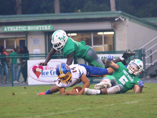 Fort Myers High's Jordan Weatherbee, right, tackles