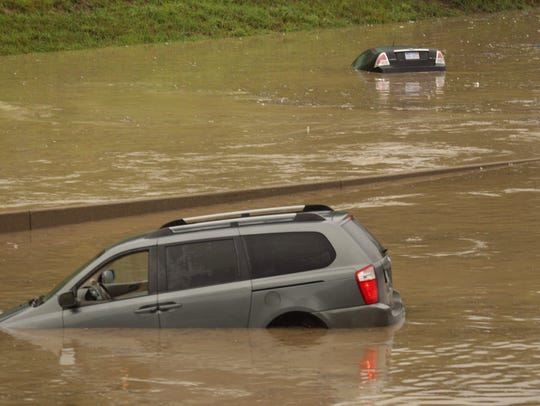 The roofs of submerged vehicles along northbound I-75