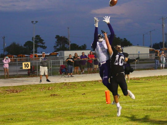 Cypress Lake's Tim Addison goes up for the ball against