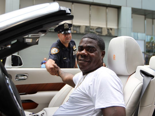 Actor Tracy Morgan posses for a photo with a member
