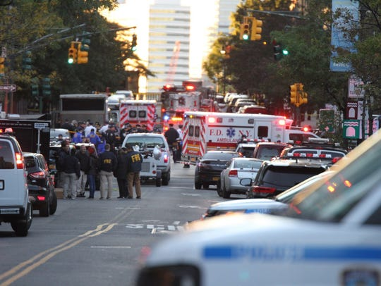 First responders and NYPD respond to a car incident in lower Manhattan after a man drove a car along a bike path.