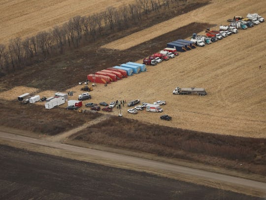 TransCanada workers are shown preparing to clean up