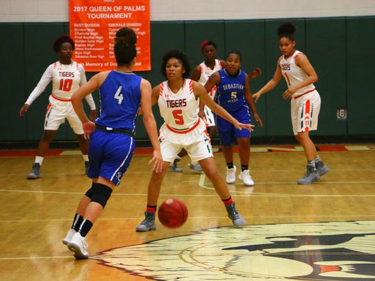 Action from Dunbar's 40-33 win over Sebastian River Thursday in a Queen of Palms quarterfinal.