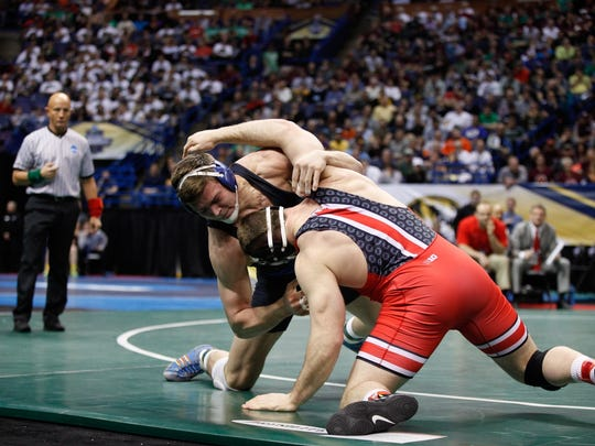 Lexington grad Jacob Kasper battles Olympic champion Kyle Snyder of Ohio State in the semifinals of the NCAA Tournament.