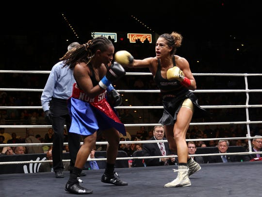 Ikram Kerwat, who trains with Roy Jones Jr., throws a right hand in her fight against Angel Gladney of Columbia, South Carolina. Kerwat won a unanimous decision to claim the WBU women's lightweight title.