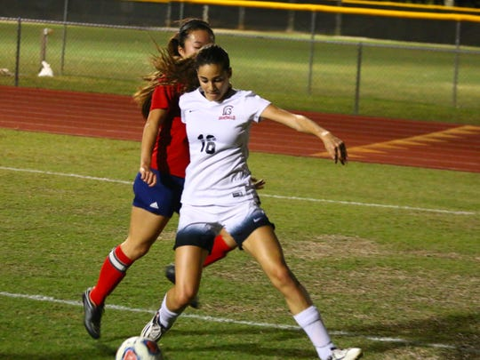 Scenes from Evangelical Christian School's 7-0 Region A-2 Final win against Indian Rocks. Sierra Oliveira goes around an Indian Rocks defender.