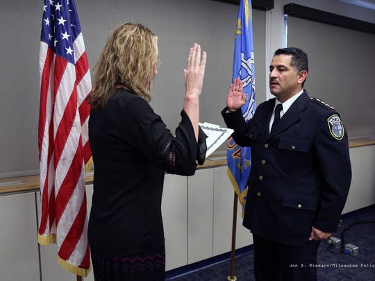 MaryNell Regan, then the Fire and Police Commission executive director, swears in Alfonso Morales as Milwaukee's interim police chief in 2018.