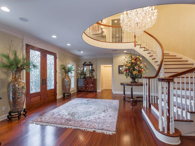 4945 Castayls Road, the formal entry and elegant staircase.