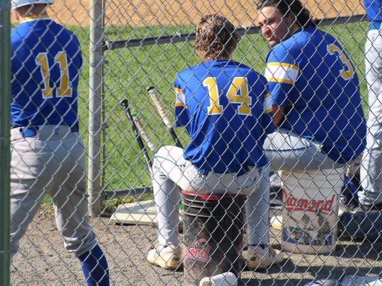 Spotswood catcher Mike Izzo (3) seated next batterymate