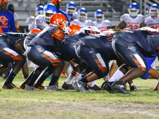 Game action from the Cape Coral vs. Dunbar spring football