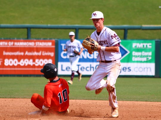 Madison County shortstop Dylan Bass records an out at second base as a Trenton base runner slides in during Friday's Class 1A state semifinal in Fort Myers.
