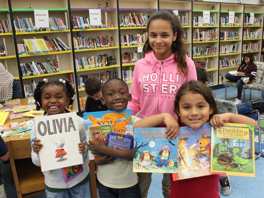 New books for the summer make these Northport K-8 students very happy! The books were donated by First United Methodist Church of Port St. Lucie and 1 PSL Church.