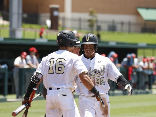 Vanderbilt freshman Jayson Gonzalez, right, celebrates