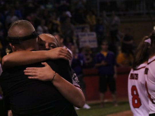 Cardington assistant coach Joel Partlow hugs senior