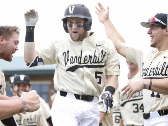 Vanderbilt freshman Philip Clarke (5) celebrates after hitting the second of back-to-back home runs in the third inning against Clemson on June 3, 2018.
