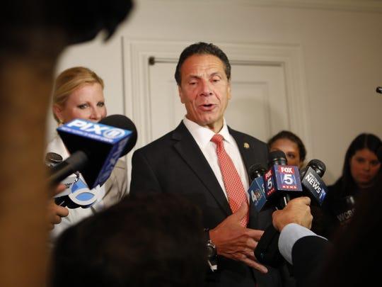 New York Governor Andrew Cuomo votes at the Presbyterian
