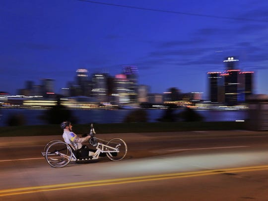 A wheeler goes by  Riverside Drive in Windsor Canada during the 37th Annual Detroit Free Press/Talmer Bank Marathon in Detroit on Sunday, Oct. 19, 2014.