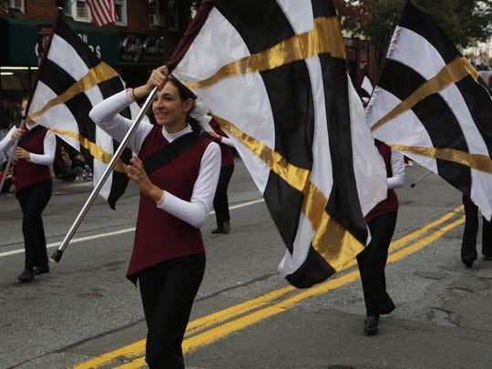The Harrison High School colorguard crew preforming at It's Great to Live in Harrison Celebration Monday, Oct. 13.