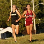 Corning's Jessica Lawson, left, and Elmira's Abbey Wheeler run side-by-side early in the STAC West cross country four-team meet on Tuesday in Elmira. Lawson finished first and Wheeler second; Ithaca's Lizzy Rayle placed sixth.