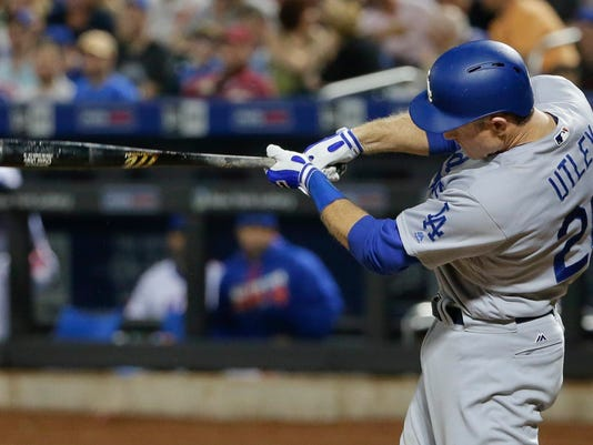Los Angeles Dodgers' Chase Utley hits a Grand Slam home run during the seventh inning of a baseball game against the New York Mets, Saturday, May 28, 2016, in New York. (AP Photo/Frank Franklin II)