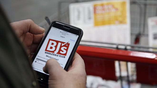 Tony D'Angelo logs into the stores Wi-Fi to download the BJ's Express Scan app on his cell phone before beginning his shopping at the BJ's Wholesale Club in Northborough, Mass. BJ's Wholesale Club is going public, again. BJ's has announced that it filed a form S-1 with the U.S. Securities and Exchange Commission for an initial public offering.
