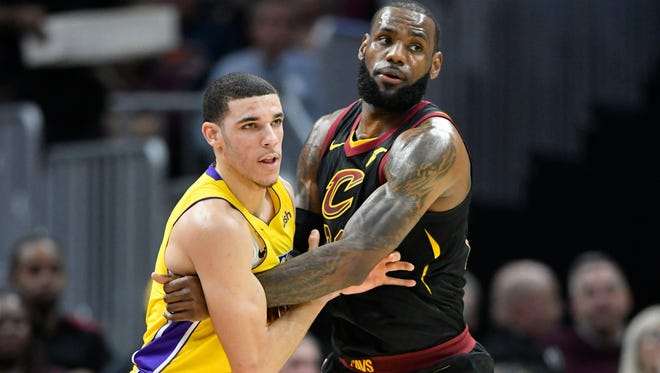 Los Angeles Lakers guard Lonzo Ball (2) defends Cleveland Cavaliers forward LeBron James (23) in the first quarter at Quicken Loans Arena.