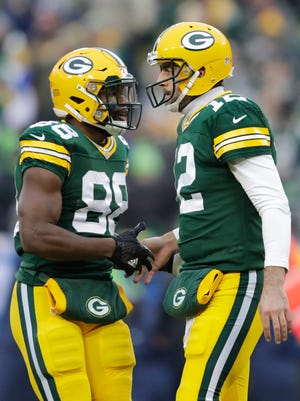 Green Bay Packers' Ty Montgomery congratulates Aaron Rodgers on a touchdown pass to Davante Adams in the first quarter.  The Green Bay Packers host the Seattle Seahawks Sunday, December 11, 2016, at Lambeau Field in Green Bay, Wis.