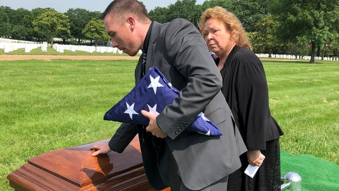 (L-R) Leroy's great-nephew Arthur Heilman II and Leroy's niece Bernadetta Heilman Largent take a moment after the service to pay their final respects to a man that, even though they never knew him, gave the ultimate sacrifice for his nation.