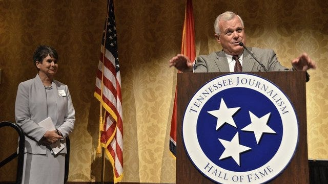 Sam Venable, columnist for the Knoxville News Sentinel, speaks at the Tennessee Journalism Hall of Fame induction ceremony at Middle Tennessee State University, Tuesday, August 12, 2014.  At left is WSMV anchor Demetria Kalodimos, who served as the event's emcee.  (Andrew Oppmann / Middle Tennessee State University)